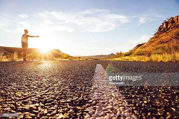 Australia, Young woman hitchhiking