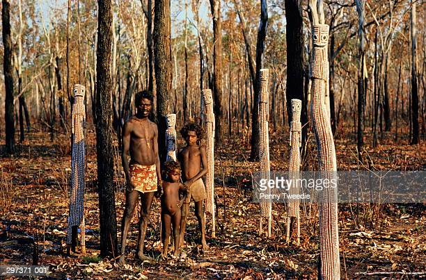 Australia,Arnhem Land,Aboriginal family amongst sculptures in wood