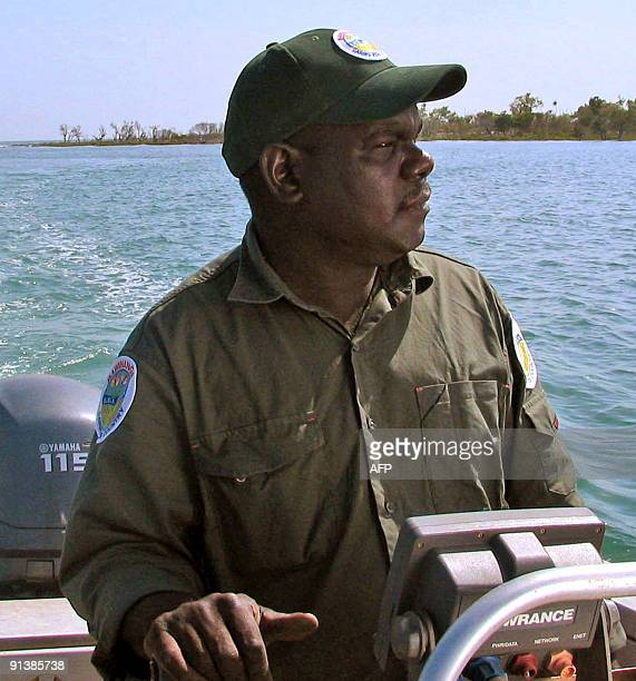 Australiaenvironmentnativefishing BY NEIL SANDS This photo taken on September 25 2009 shows Aboriginal sea ranger Dion Cooper driving his patrol boat...