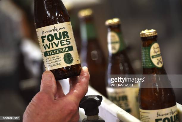 AustraliaLifestylebeer FEATURE by Madeleine Coorey A photo taken on September 3 shows bottles of James Squire on the production line at the Malt...