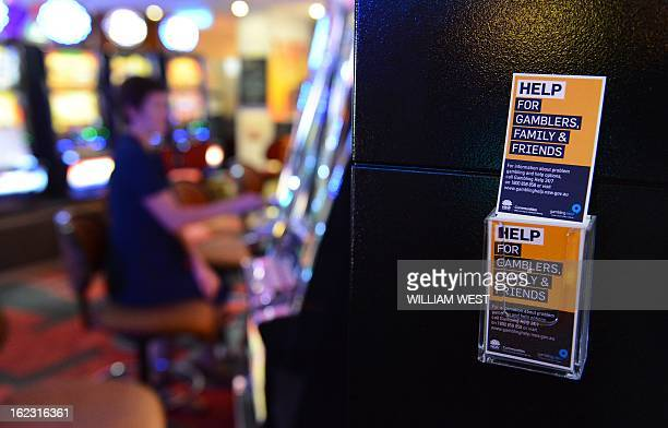 AustraliaLifestylegamblingFEATURE by Madeleine Coorey This photo taken on December 21 2012 shows a leaflet for problem gamblers posted on the side of...
