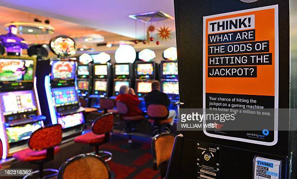 AustraliaLifestylegamblingFEATURE by Madeleine Coorey This photo taken on December 21 2012 shows a warning sign for gamblers posted on the side of an...