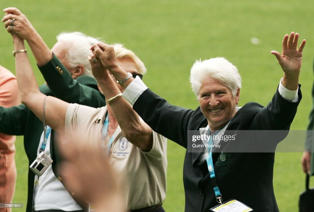 Australian 1956 Olympic representitives including Dawn Fraser wave to the crowd during the 50th anniversary of the 1956 Melbourne Olympic Games at the Melbourne Cricket Ground November 19, 2006 in Melbourne, Australia.