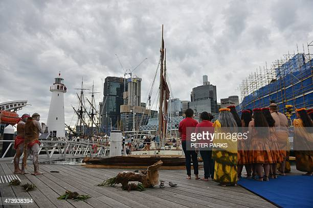 Australian Aboriginal elders and members of the Polynesian Voyaging Society wait the arrival of the voyaging canoe Ho¯ku¯lea on its 47000 nautical...