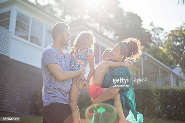 australian aboriginal family enjoying in the garden at home - mid adult men stock pictures, royalty-free photos & images