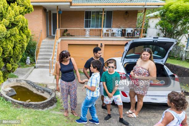 Australian Aboriginal Family Preparing to Pack the Car for a BBQ