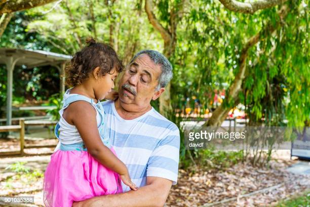 Australian Aboriginal Man Hugging His Grandaughter
