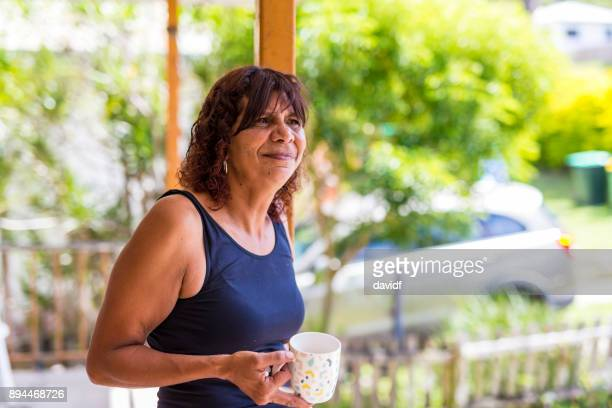 Australian Aboriginal Mother Enjoying a Cup of Coffee at Home