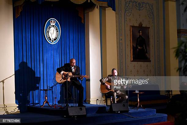 Australian aboriginal musician Archie Roach performs for the US Vice President Joe Biden during a dinner held by the Governor of Victoria Linda...