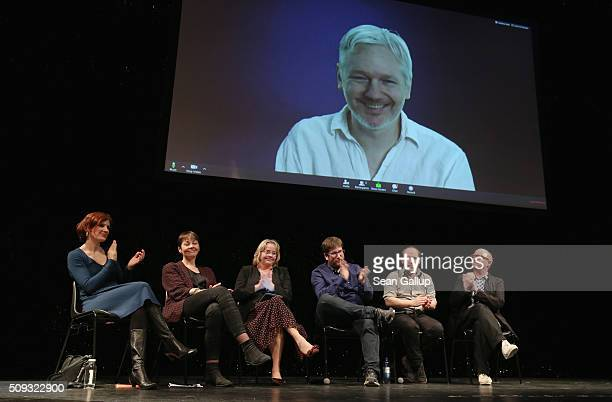 Australian activist Julian Assange speaks via a live broadcast at the official launch of the Democracy in Europe Movement 2025 as leftleaning...