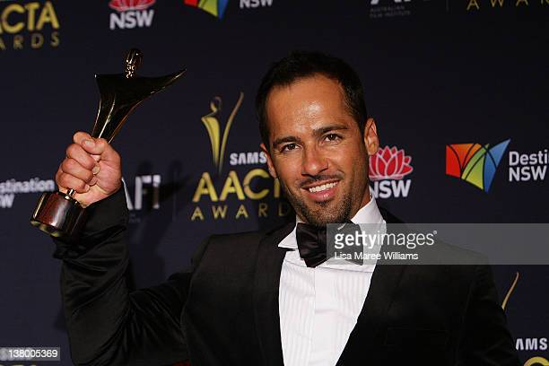 Australian actor Alex Dimitriades poses with his AACTA Award for Best Lead Actor in a Television Drama for his role in The Slap at the 2012 AACTA...