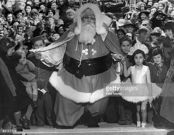 Australian actor Barney Worth at Kennards Christmas Show in Wimbledon where he is playing the part of Santa Claus 19th November 1941 Worth weighs 42...