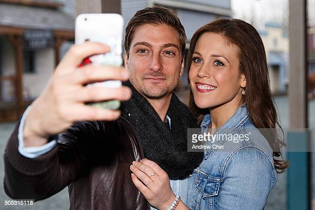 Australian actor Daniel Lissing and American actress Erin Krakow take a selfie during Hearties Family Reunion fan convention for 'When Calls The...