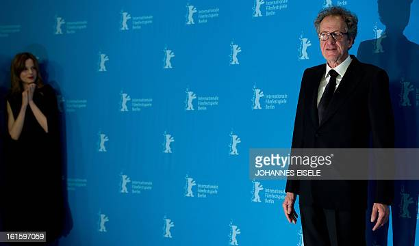 """Australian actor Geoffrey Rush poses next to Dutch actress Sylvia Hoeks during a photocall for the film """"The Best Offer"""" presented in the Berlinale..."""