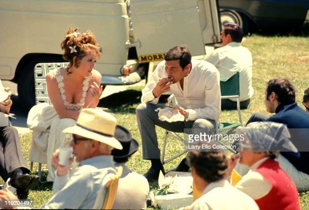 Australian actor George Lazenby and English actress Diana Rigg relax on the set of the James Bond film 'On Her Majesty's Secret Service' 1969