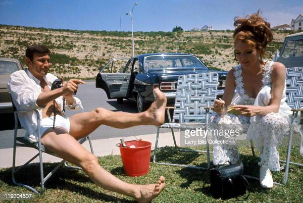 Australian actor George Lazenby and English actress Diana Rigg relax on the set of the James Bond film 'On Her Majesty's Secret Service', 1969.