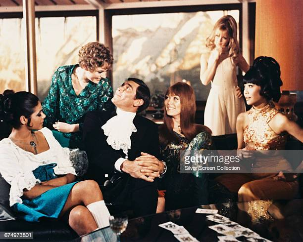 Australian actor George Lazenby as James Bond in the film 'On Her Majesty's Secret Service' 1969 The actresses with him are Ingrid Back Angela...