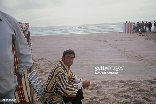 Australian actor George Lazenby during the filming of the James Bond movie 'On Her Majesty's Secret Service' on location on the Praia do Guincho near...
