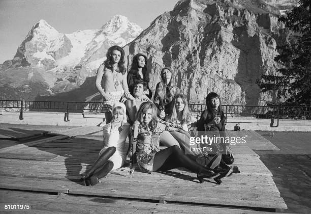 Australian actor George Lazenby poses with several of his female costars whilst filming the new James Bond film 'On Her Majesty's Secret Service' in...
