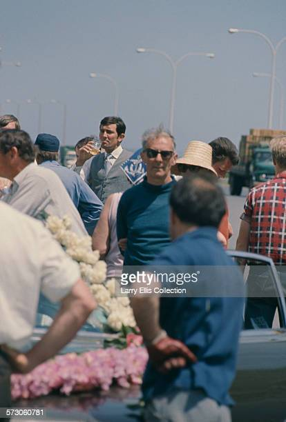 Australian actor George Lazenby taking refreshments on the set of the James Bond film 'On Her Majesty's Secret Service' on location in Portugal 1969