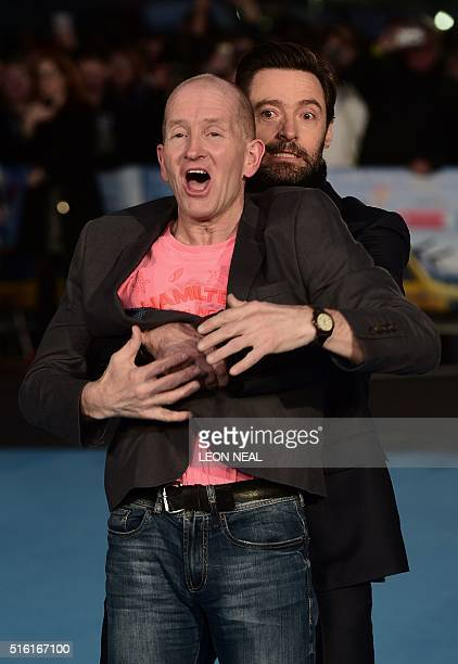 Australian actor Hugh Jackman fools around with British former Olympic ski jumper Eddie 'the eagle' Edwards on the red carpet as they arrive for the...