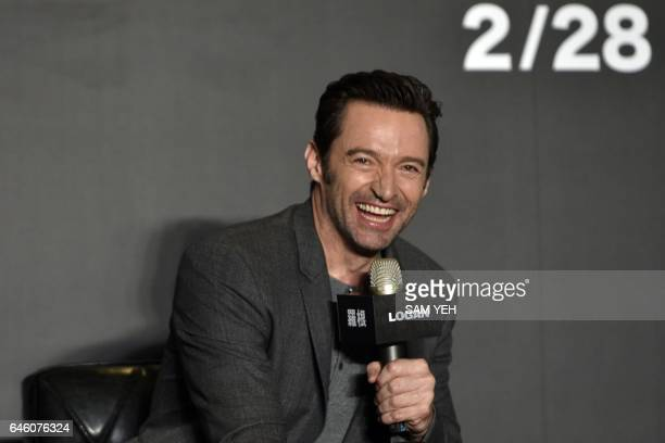 Australian actor Hugh Jackman laughs during a press conference for the film 'Logan' in Taipei on February 28 2017 Jackman and fellow cast member...