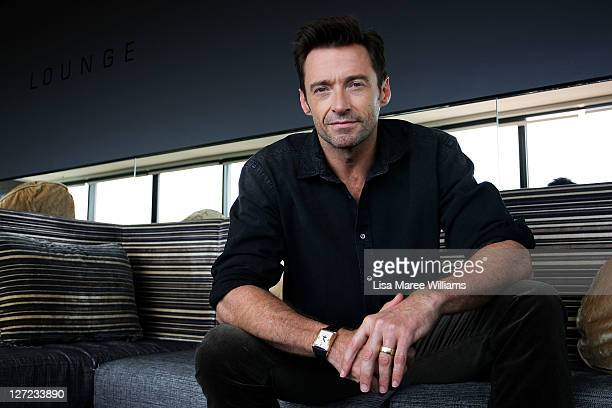 Australian actor Hugh Jackman poses during a photo call to promote his new film Real Steel at the Intercontinental Hotel on September 27 2011 in...