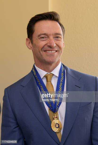 Australian actor Hugh Jackman poses for photographs after being awarded an Order of Australia by The GovernorGeneral of Australia David Hurley at...