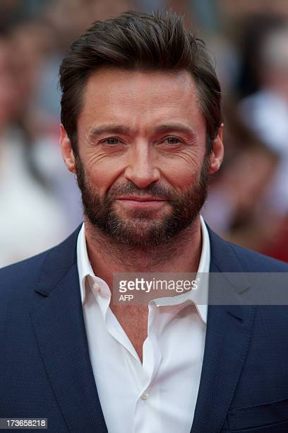 Australian actor Hugh Jackman poses for pictures on the red carpet as he arrives for the UK premier of the film 'The Wolverine' in London on July 16...