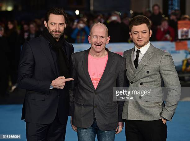 Australian actor Hugh Jackman poses with British former Olympic ski jumper Eddie 'the eagle' Edwards and British actor Taron Egerton on the red...