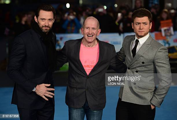 Australian actor Hugh Jackman poses with British former Olympic ski jumper Eddie 'the eagle' Edwards and British actor Taron Egerton as they arrive...
