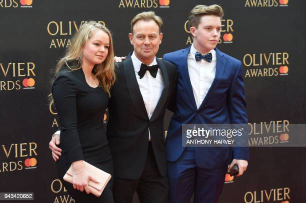 Australian actor Jason Donovan poses with children Jemma and Zac on the red carpet upon arrival to attend The Olivier Awards at the Royal Albert Hall...