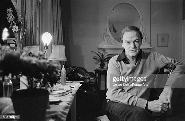 Australian actor Keith Michell pictured sitting on a chair in London on 27th March 1979