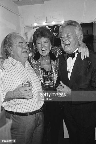 Australian actor Leo McKern English singer and television presenter Cilla Black and Danny La Rue circa 1985