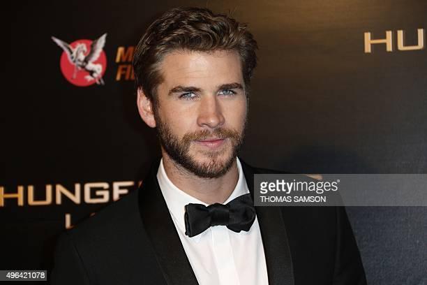 """Australian actor Liam Hemsworth poses on the red carpet upon his arrivel for """"The Hunger Games: Mockingjay - Part 2"""" premiere at the Grand Rex in..."""