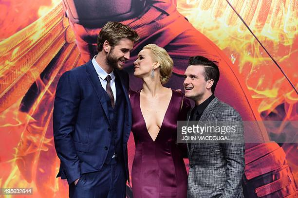 Australian actor Liam Hemsworth, US actress Jennifer Lawrence and US actor Josh Hutcherson pose for photographers on the red carpet as they arrive...