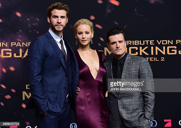Australian actor Liam Hemsworth, US actress Jennifer Lawrence, and US actor Josh Hutcherson pose for photographers on the red carpet as they arrive...