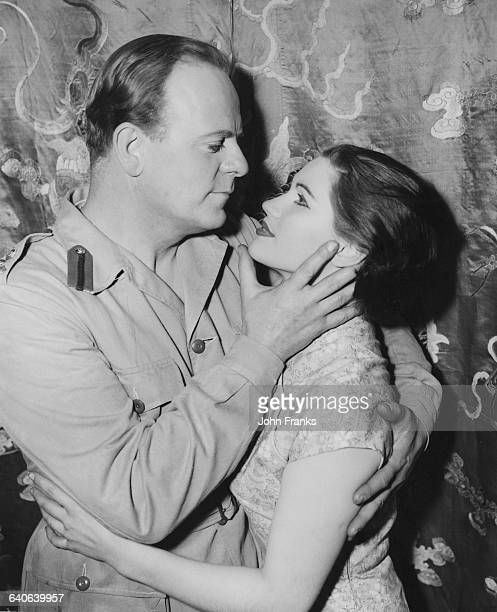 Australian actor Lloyd Lamble as Brigadier Evan Carding and English actress Silvia Herklotz as Suling during a rehearsal for the play 'The Final Ace'...