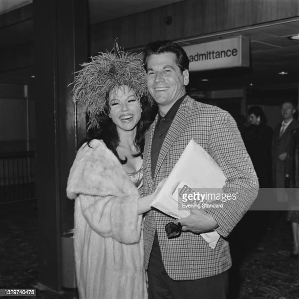 Australian actor Ron Randell with his wife, actress and dancer Laya Raki , UK, 23rd November 1964.
