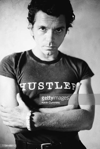Australian actor, singer and musician Michael Hutchence wearing a 'Hustler' t-shirt in Nice, 23rd August 1995.