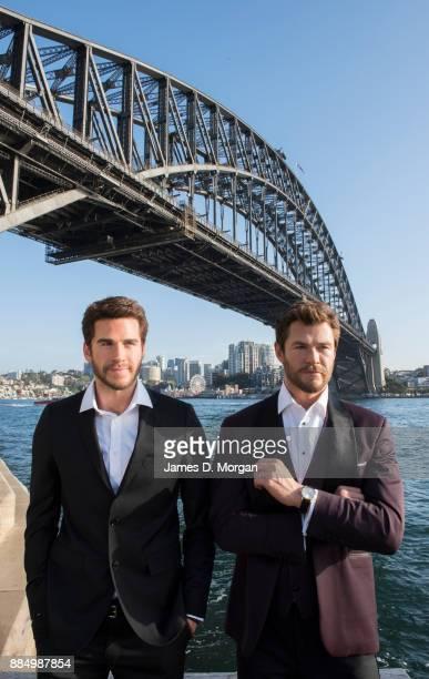 Australian actors Liam Hemsworth with his brother Chris Hemsworth as wax figures on November 2, 2017 in Sydney, Australia. Sydney's Madame Tussauds...