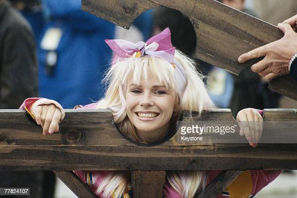 Australian actress and comedienne Pamela Stephenson is put in a pillory during a charity edition of the TV programme 'It's A Knockout' 15th June 1987