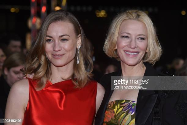 Australian actress and producer Cate Blanchett and Australian actress Yvonne Strahovski pose on the red carpet upon arrival for the screening of the...