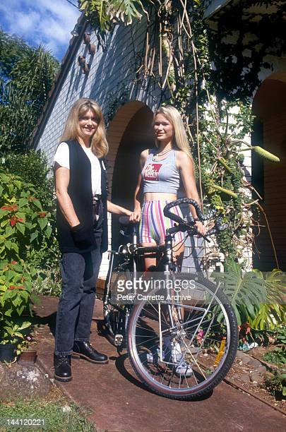 Australian actress and singer Olivia NewtonJohn with cyclist Cindy Jessup at Olivia's home in May 1994 in Byron Bay Australia Cindy is planning a...
