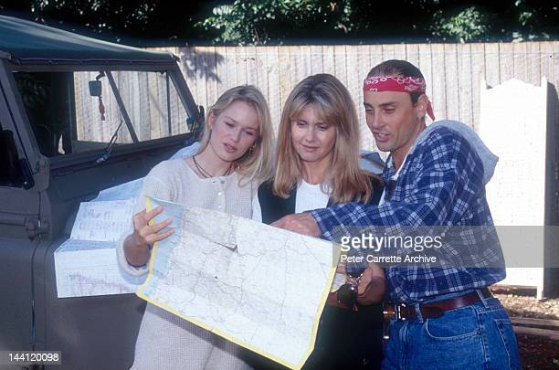 Australian actress and singer Olivia NewtonJohn with her husband Matt Lattanzi and cyclist Cindy Jessup at Olivia's home in May 1994 in Byron Bay...