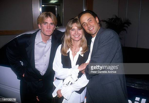 Australian actress and singer Olivia NewtonJohn with her nephew Emerson NewtonJohn and husband Matt Lattanzi at a fundaising event for cyclist Cindy...