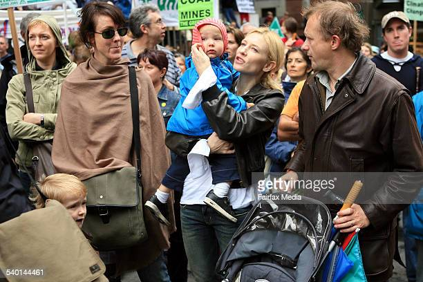 Australian actress Cate Blanchett centre with her husband playwright Andrew Upton right during a Walk Against Warming rally in Sydney The rally was...