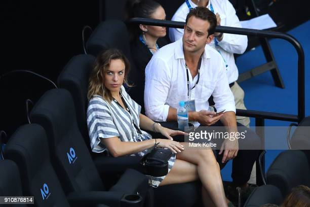 Australian actress Jessica McNamee watches the women's singles final between Caroline Wozniacki of Denmark and Simona Halep of Romania on day 13 of...