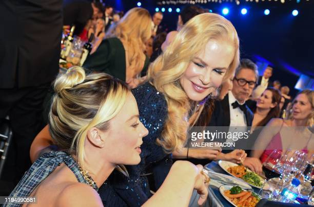 Australian actress Margot Robbie and Australian actress Nicole Kidman talk during the 26th Annual Screen Actors Guild Awards show at the Shrine...