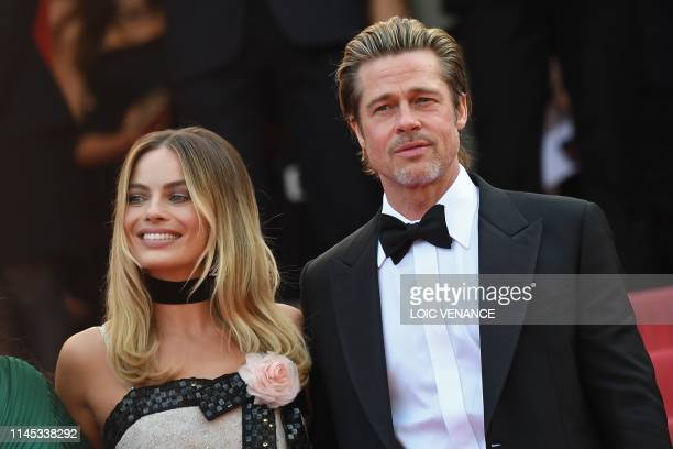 Australian actress Margot Robbie and US actor Brad Pitt pose as they arrive for the screening of the film Once Upon a Time in Hollywood at the 72nd...